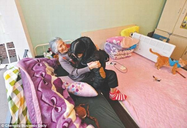 Liu and her grandmother live in a tiny rented room near Liu's university in Chengdu, China