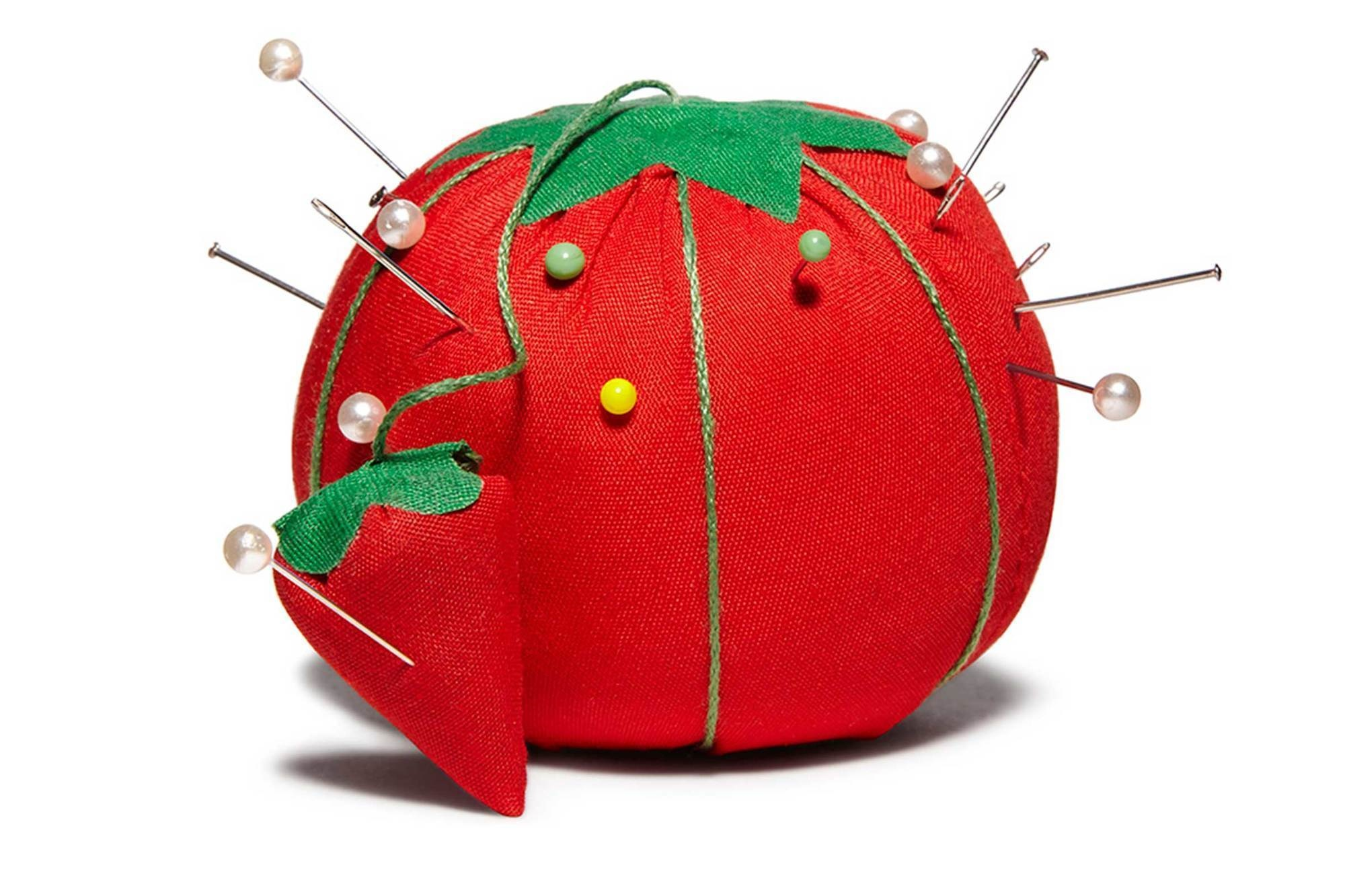 That Baby Strawberry Next To The Big Pincushion