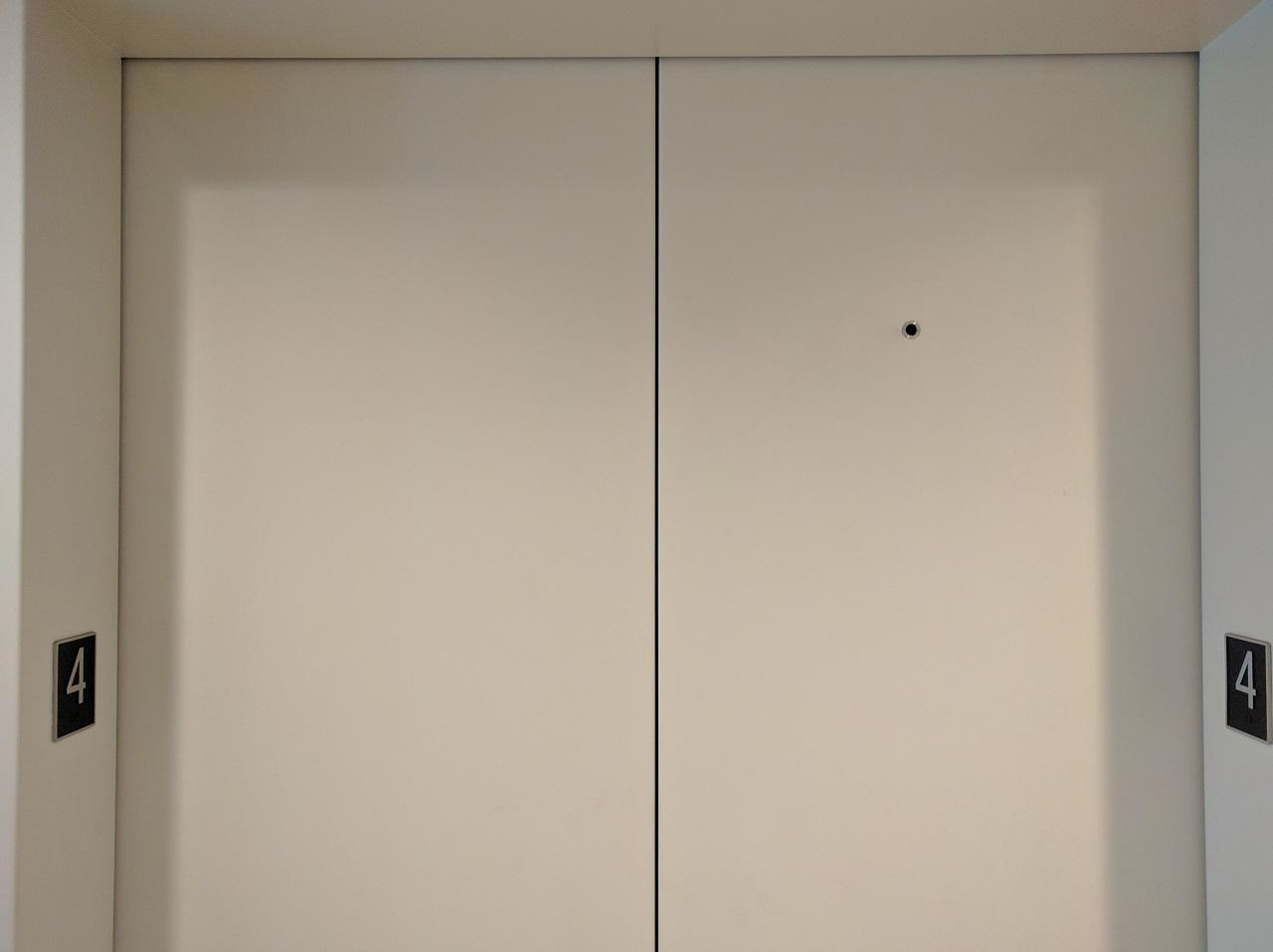 That Tiny Hole On Elevator Doors