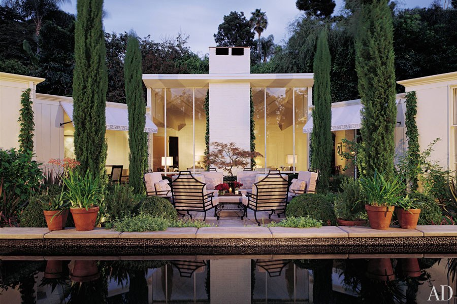 The pool and terrace serve as the focal point of designer Greg Jordan's V-shaped Hollywood Hills residence. The exterior space even informs the interiors—a pair of sofas in the living room are aligned with the cypress trees. (September 2004)