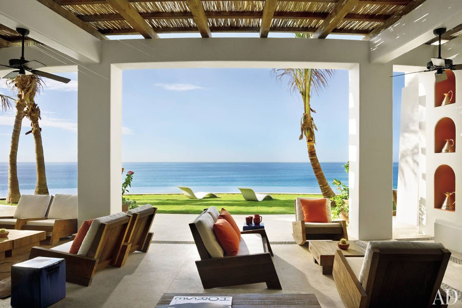 The architecture firm Ike Kligerman Barkley used outdoor rooms to extend a house in Cabo San Lucas, Mexico, into the surrounding landscape. This veranda offers panoramic views over the infinity pool to the ocean beyond.