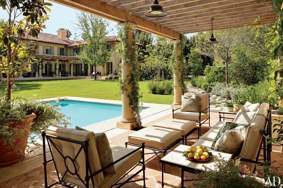 This terrace at James and Jennifer Belushi's Los Angeles home overlooks the pool and the rear garden, which was landscaped by Mia Lehrer. The wrought-iron furniture gives the space a polished yet casual feel.