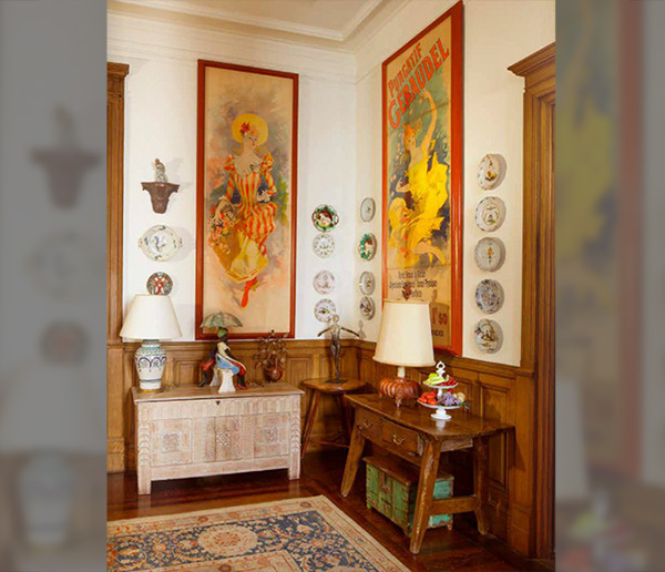 French Posters And Fine China In The Formal Dining Room