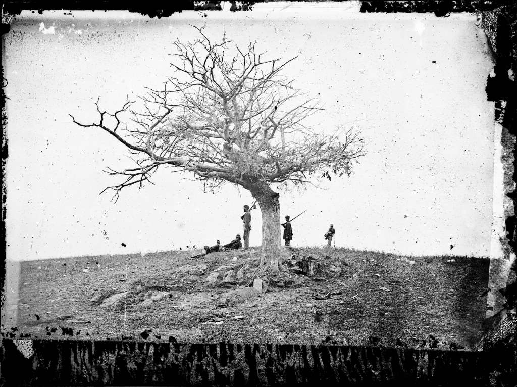 This 1862 photo made available by the Library of Congress shows soldiers next to a lone grave after the Battle of Antietam near Sharpsburg, Md. When dawn broke along Antietam Creek on Sept. 17, 1862, cannon volleys launched a Civil War battle that would leave 23,000 casualties on the single bloodiest day in U.S. history and mark a crucial pivot point in the war. And yet it might never have occurred - if not for what a historian calls a