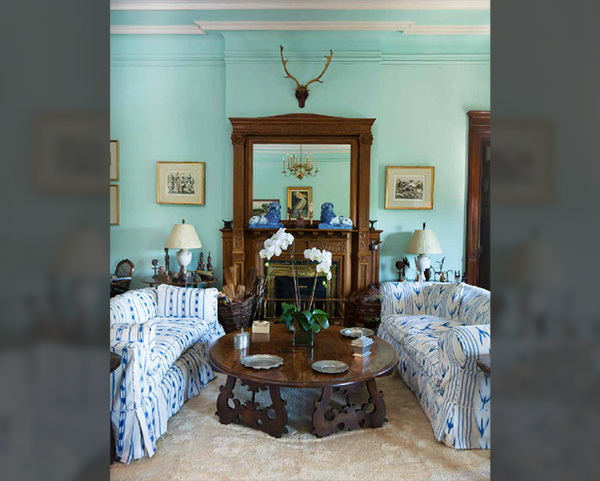 Carved Fireplaces, Crown Moldings, and Not Your Average Grandmother's Couches