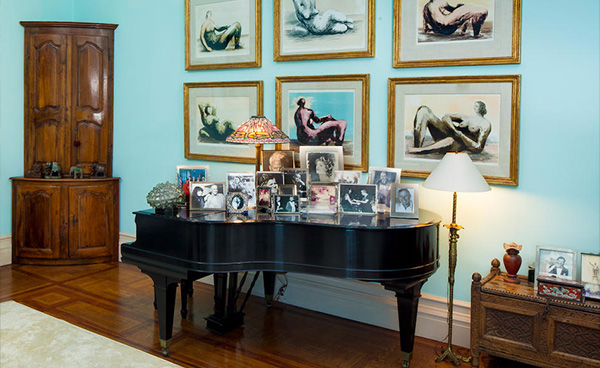 A Baby Grand With Framed Figure Drawings