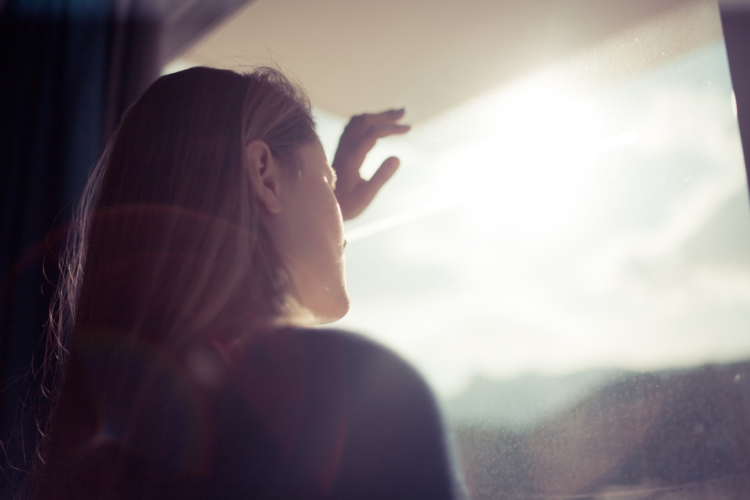 Image result for woman staring out of window