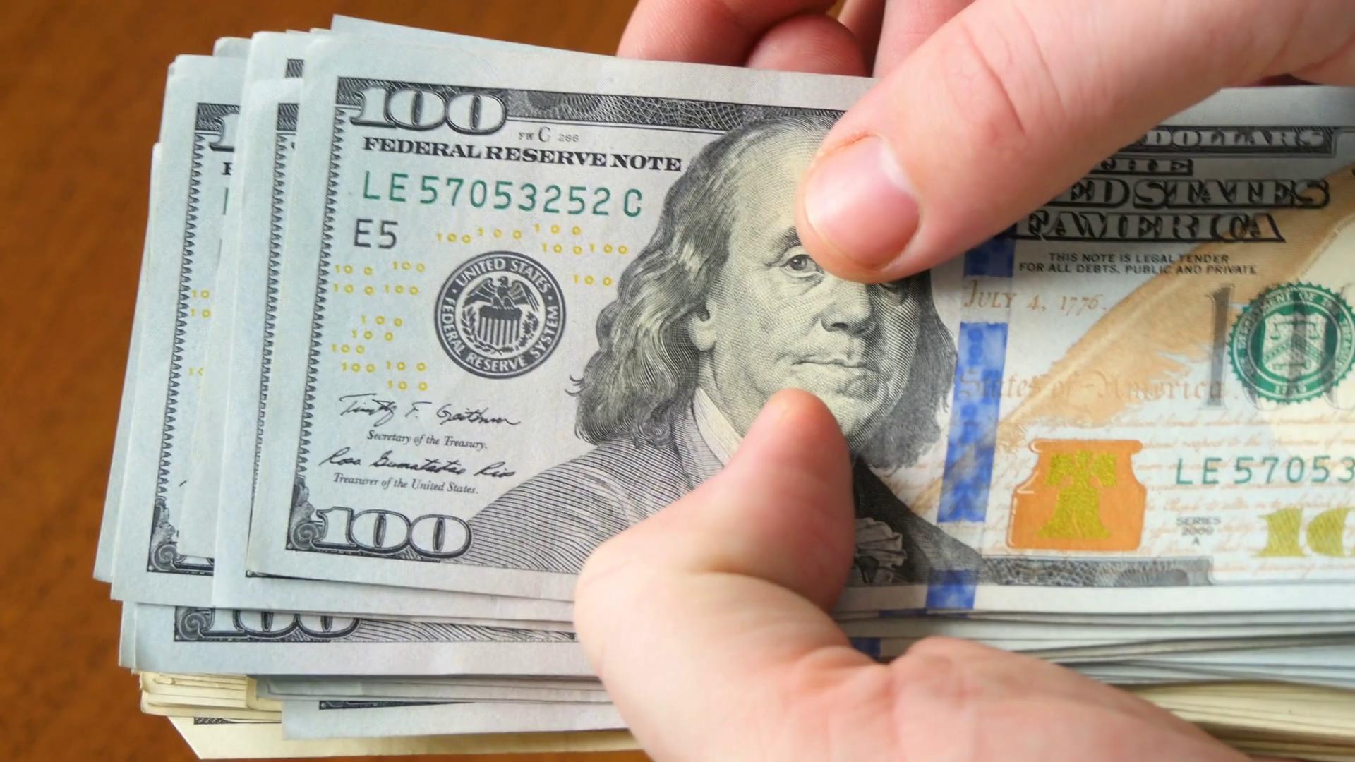 Image result for money holding